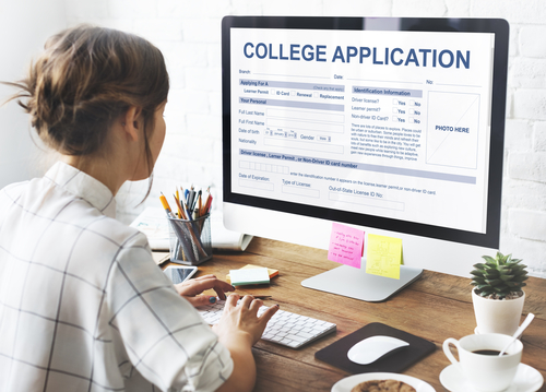 Senior year high school student completing a college application