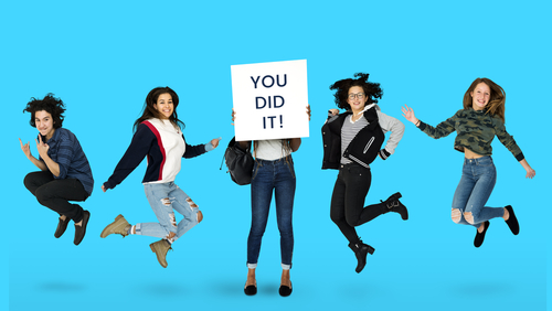 "Seniors in high school jumping for joy with a ""you did it"" sign"