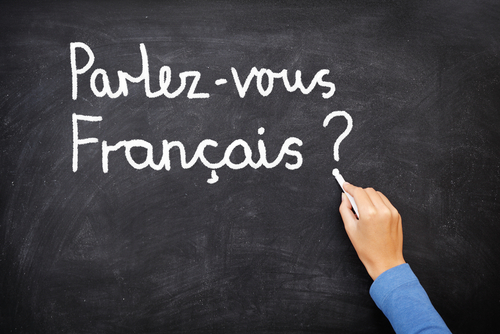 """Parlez-vous Francais"" spelled out on a chalkboard"