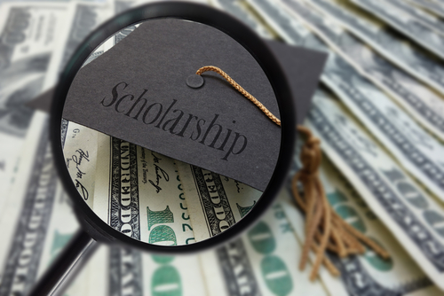 Magnifying glass looking for scholarship money